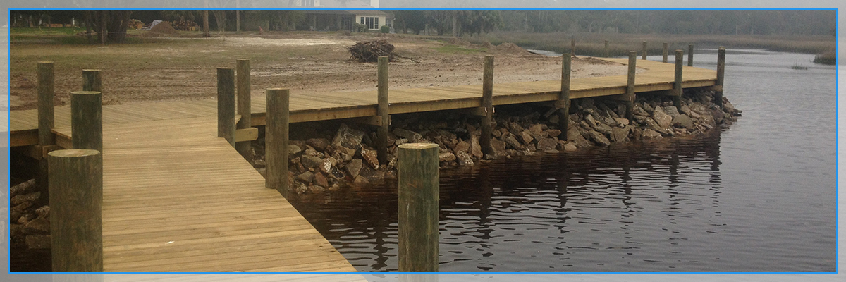 A picture of a bulkhead structure next to a beach dock.